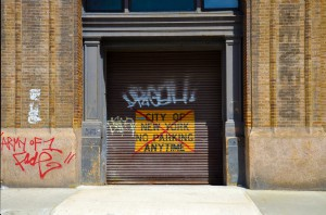 An exhibition of grafitti on the walls of a building in NYC.